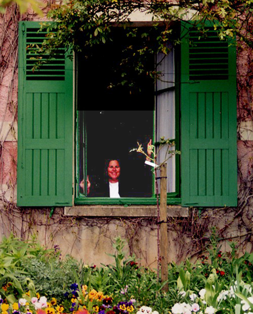 Cathryn Hatfield looking through Monet's window at Giverny